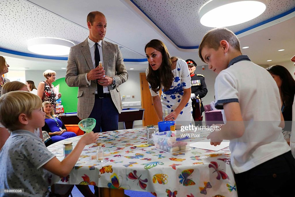 Catherine Duchess of Cambridge and Prince William Duke of Cambridge are presented with a personalised memory jar by Jamie Coniam and Ethan Coniam...
