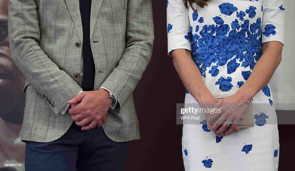 Catherine Duchess of Cambridge and Prince William Duke of Cambridge clothing detail listen to a speech during their visit to Keech Hospice Care on...