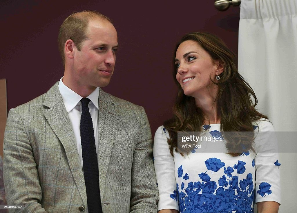 Catherine Duchess of Cambridge and Prince William Duke of Cambridge listen to a speech during their visit to Keech Hospice Care on August 24 2016 in...