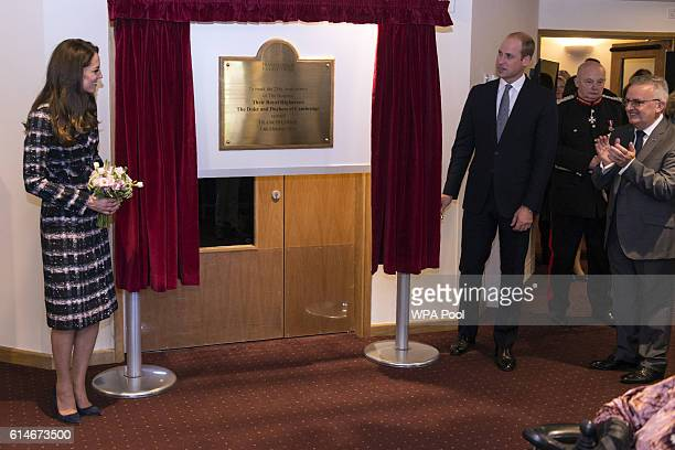 Catherine Duchess of Cambridge and Prince William Duke of Cambridge unveil a plaque at Francis House which provides end of life care and bereavement...