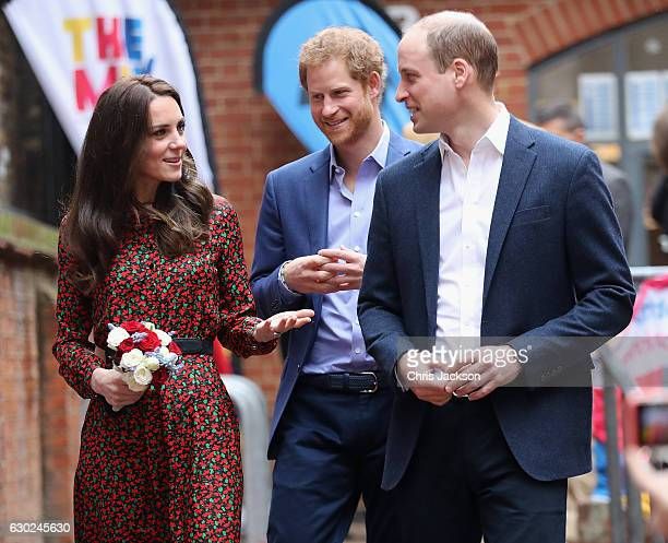 Catherine Duchess of Cambridge and Prince William Duke of Cambridge with Prince Harry attend a Christmas party for volunteers at The Mix youth...