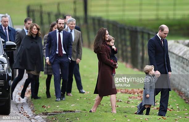 Catherine Duchess of Cambridge and Prince William Duke of Cambridge Prince George of Cambridge Princess Charlotte of Cambridge followed by Carole...