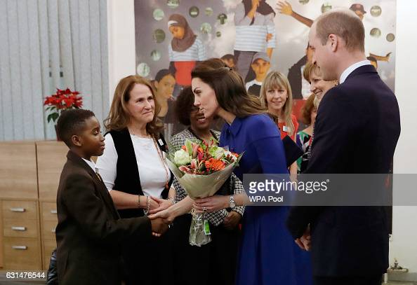 Catherine Duchess of Cambridge and Prince William Duke of Cambridge greet people as they arrive at the Child Bereavement UK Centre in Stratford on...