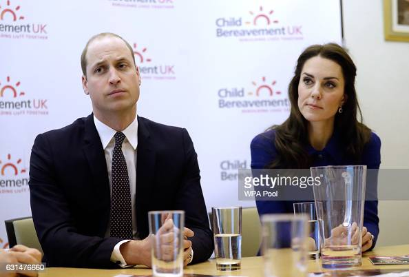 Catherine Duchess of Cambridge and Prince William Duke of Cambridge listen during a meeting with professionals at the Child Bereavement UK Centre in...