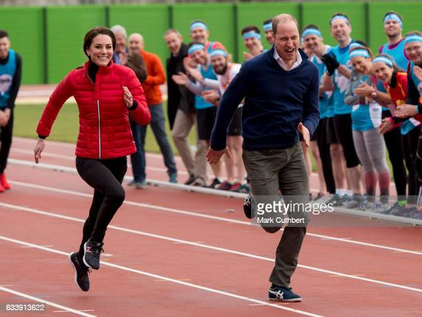 Catherine Duchess of Cambridge and Prince William Duke of Cambridge take part in a race with Prince Harry during a training day for the Heads...