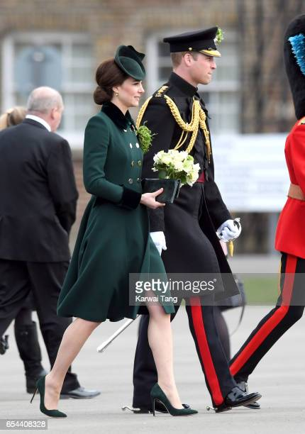 Catherine Duchess of Cambridge and Prince William Duke Of Cambridge presents the 1st Battalion Irish Guardsmen with shamrocks during the annual Irish...