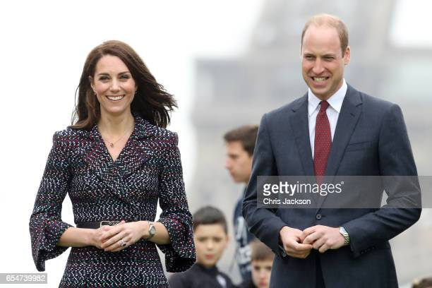 Catherine Duchess of Cambridge and Prince William Duke of Cambridge pose at the Trocadero in front of the Eiffel tower during an official twoday...