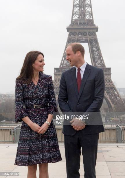 Catherine Duchess of Cambridge and Prince William Duke of Cambridge pose in front of the Eiffel tower as they visit a 'Les Voisins in Action' event...