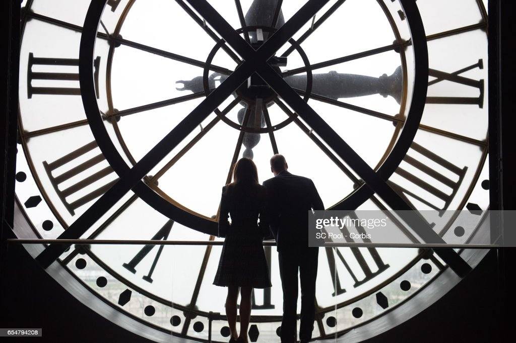 Catherine, Duchess of Cambridge and Prince William, Duke of Cambridge look through the clock at Musee d'Orsay during an official two-day visit to Paris on March 18, 2017 in Paris, France.