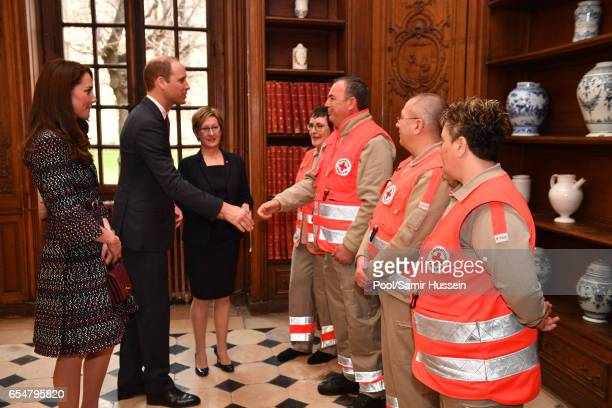 Catherine Duchess of Cambridge and Prince William Duke of Cambridge meet some paramedics as they visit the Invalides on March 18 2017 in Paris France...