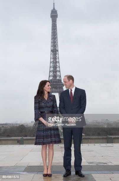 Catherine Duchess of Cambridge and Prince William Duke of Cambridge pose in front of the Eiffel Tower at the Trocadero square on March 18 2017 in...