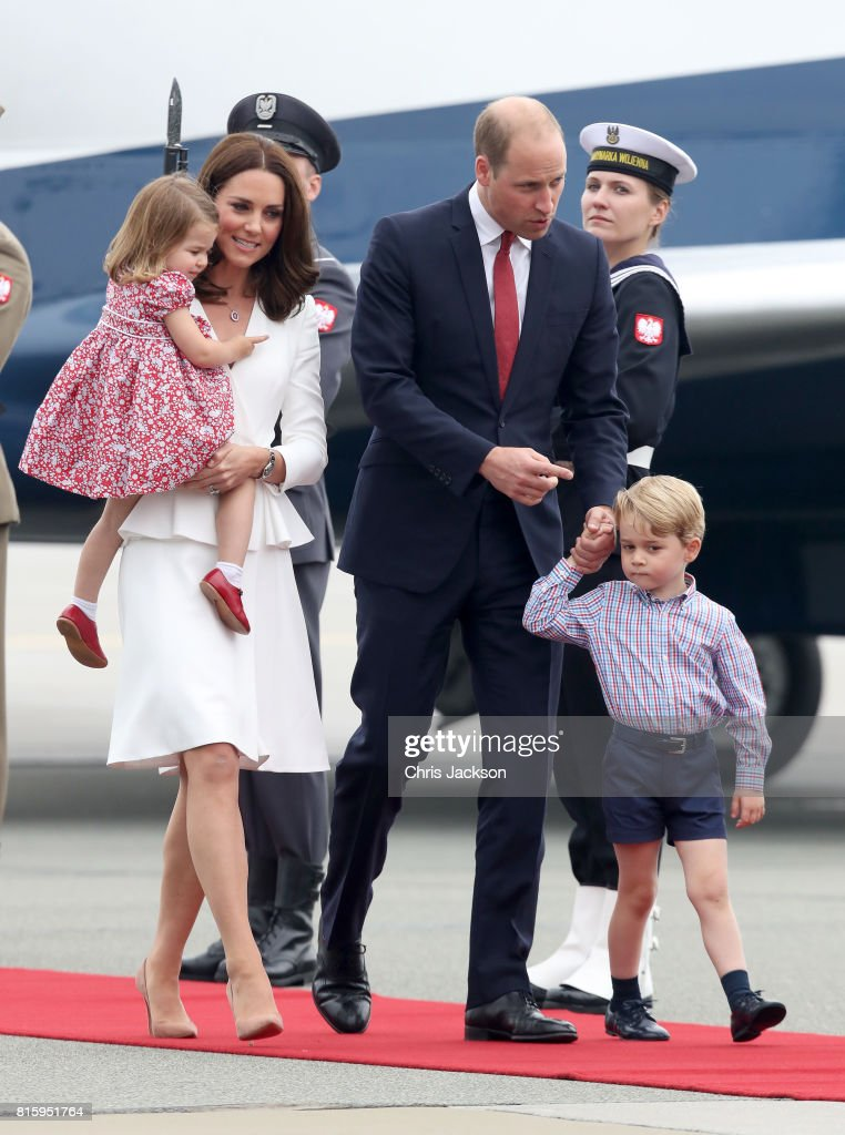 Catherine, Duchess of Cambridge and Prince William, Duke of Cambridge with their children Princess Charlotte of Cambridge and Prince George of Cambridge as they arrive on day 1 of their official visit to Poland on July 17, 2017 in Warsaw, Poland.