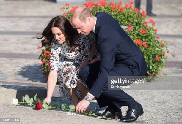 Catherine Duchess of Cambridge and Prince William Duke of Cambridge lay flowers at the Solidarity Monument at the European Solidarity Centre during...