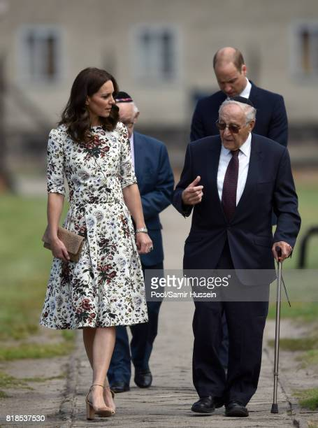 Catherine Duchess of Cambridge and Prince William Duke of Cambridge walk with survivors as they visit Stutthof the former Nazi Germany Concentration...