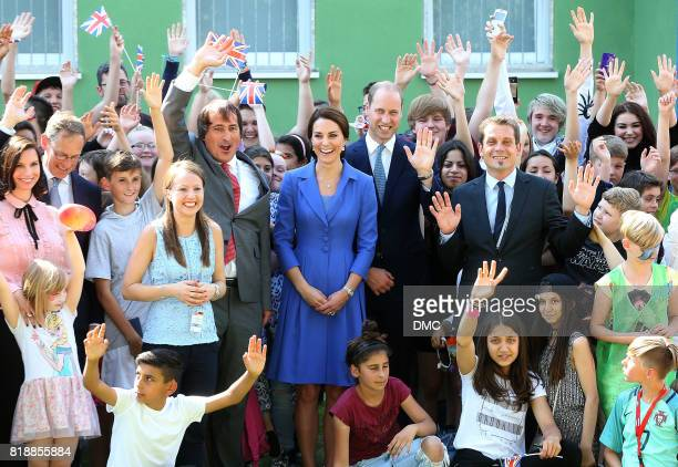 Catherine Duchess of Cambridge and Prince William Duke of Cambridge pose with children from Strassenkinder a charity that supports young people from...