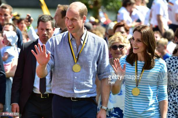 Catherine Duchess of Cambridge and Prince William Duke of Cambridge after competing as they cox of rowing boats in a friendly race between the...