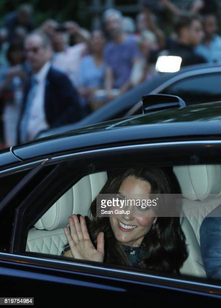 Catherine Duchess of Cambridge and Prince William Duke of Cambridge depart in a limousine after attending a reception at Claerchen's Ballhaus dance...