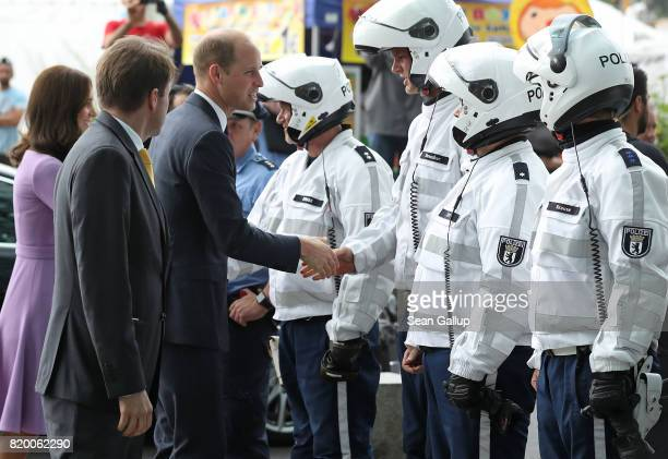 Catherine Duchess of Cambridge and Prince William Duke of Cambridge bid farewell to German police officers who had led their motorcade on motorcycles...
