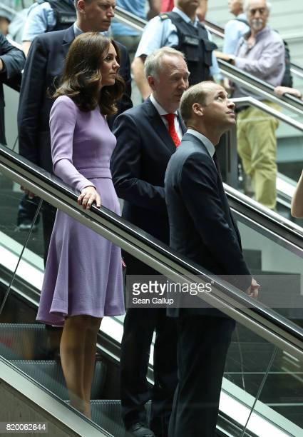 Catherine Duchess of Cambridge and Prince William Duke of Cambridge ride an escalator as they arrive at Berlin Hauptbahnhof main railway station...