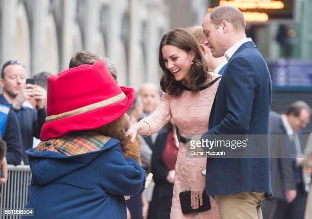 Catherine Duchess of Cambridge and Prince William Duke of Cambridge meet Paddington Bear as she attends the Charities Forum Event on board the...
