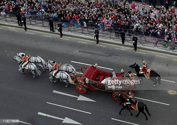 Catherine Duchess of Cambridge and Prince William the Duke of Cambridge travel to Buckingham Palace in a 1902 State Landau along the procession route...