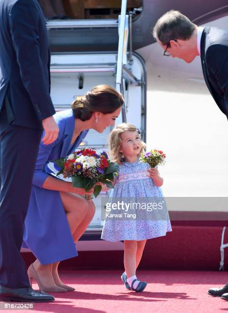 Catherine Duchess of Cambridge and Princess Charlotte arrive at Berlin's Tegel Airport during an official visit to Poland and Germany on July 19 2017...