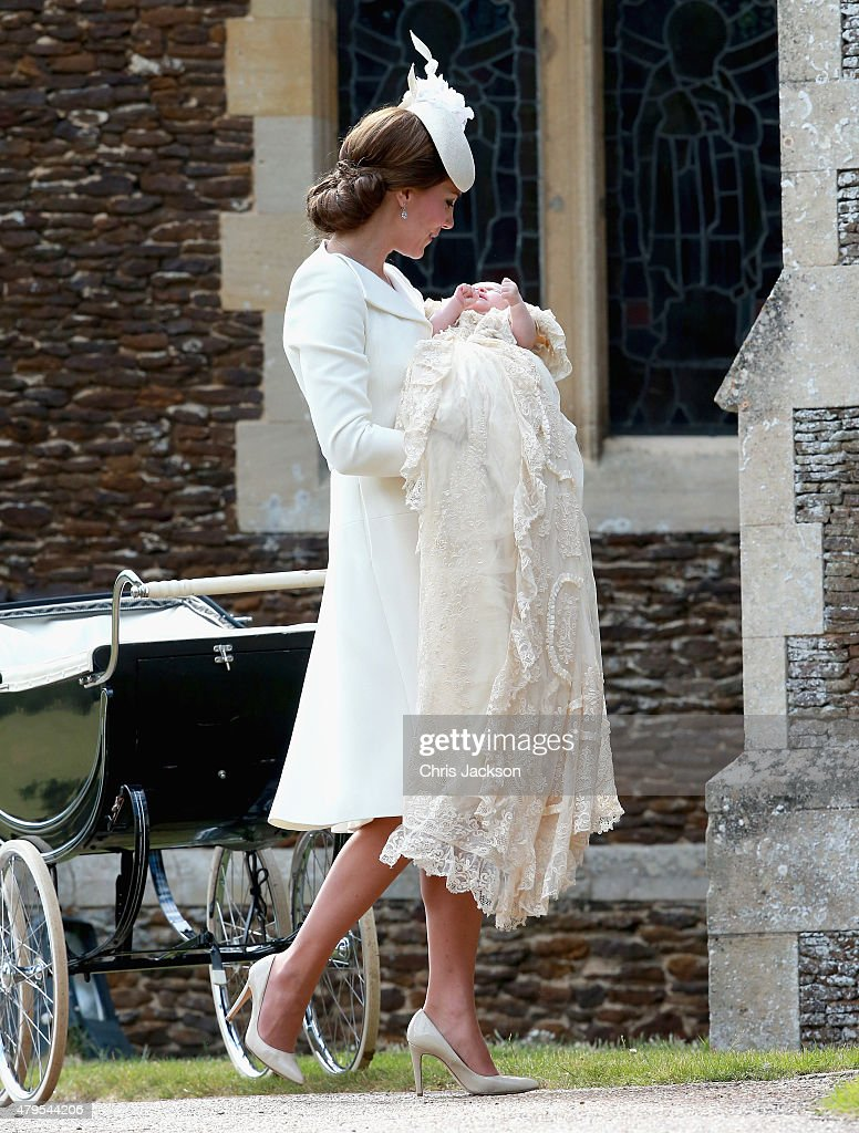 Catherine, Duchess of Cambridge and Princess Charlotte of Cambridge arrive at the Church of St Mary Magdalene on the Sandringham Estate for the Christening of Princess Charlotte of Cambridge on July 5, 2015 in King's Lynn, England.