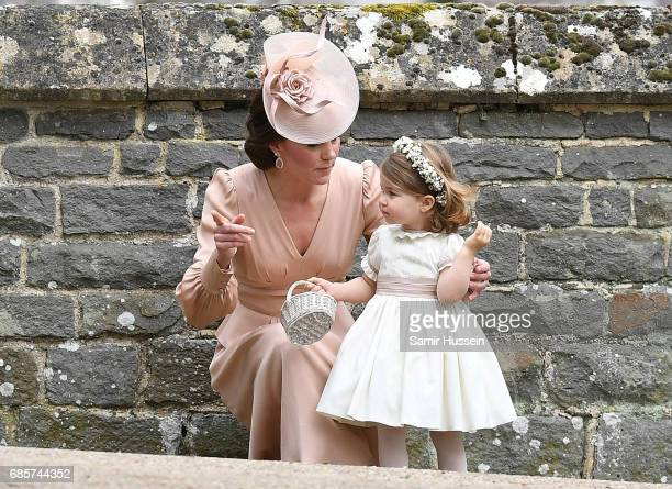 Catherine Duchess of Cambridge and Princess Charlotte of Cambridge bridesmaid leave the wedding of Pippa Middleton and James Matthews at St Mark's...
