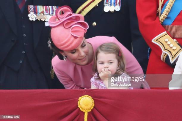 Catherine Duchess of Cambridge and Princess Charlotte of Cambridge look out from the balcony of Buckingham Palace during the Trooping the Colour...