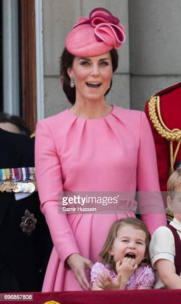 Catherine Duchess of Cambridge and Princess Charlotte of Cambridge look on from the balcony during the annual Trooping The Colour parade on June 17...