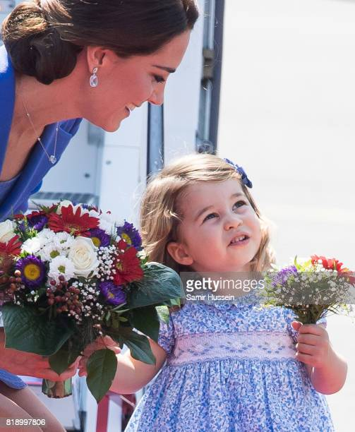 Catherine Duchess of Cambridge and Princess Charlotte of Cambridge arrive at Berlin military airport during an official visit to Poland and Germany...