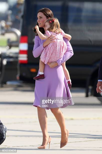 Catherine Duchess of Cambridge and Princess Charlotte of Cambridge view helicopter models H145 and H135 before departing from Hamburg airport on the...