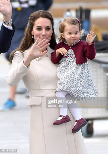 Catherine Duchess of Cambridge and Princess Charlotte wave to wellwishers as they depart Victoria after their Royal Tour of Canada on October 1 2016...