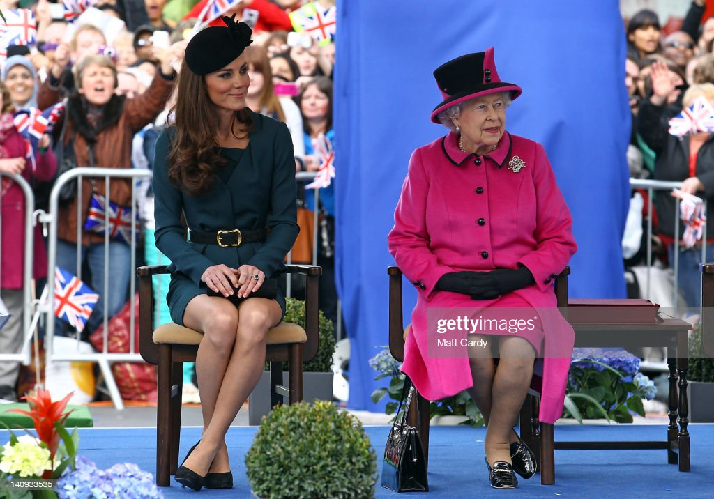 Catherine, Duchess of Cambridge (L) and Queen Elizabeth II (R) listen to a welcome speech in Leicester city centre on March 8, 2012 in Leicester, England. The royal visit to Leicester marks the first date of Queen Elizabeth II's Diamond Jubilee tour of the UK between March 8 and July 25, 2012.