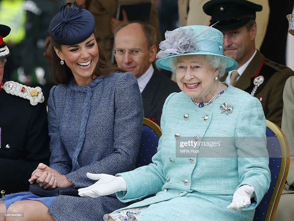 Catherine, Duchess of Cambridge and Queen <a gi-track='captionPersonalityLinkClicked' href=/galleries/search?phrase=Elizabeth+II&family=editorial&specificpeople=67226 ng-click='$event.stopPropagation()'>Elizabeth II</a> watch part of a children's sports event while visiting Vernon Park during a Diamond Jubilee visit to Nottingham on June 13, 2012 in Nottingham, England.