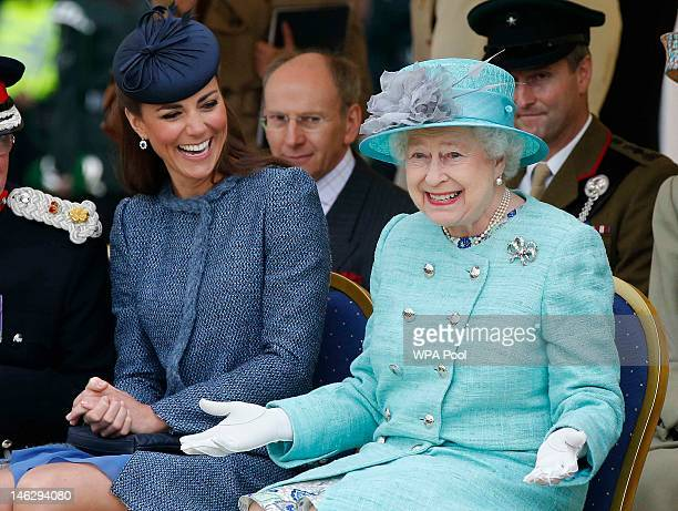 Catherine Duchess of Cambridge and Queen Elizabeth II watch part of a children's sports event while visiting Vernon Park during a Diamond Jubilee...