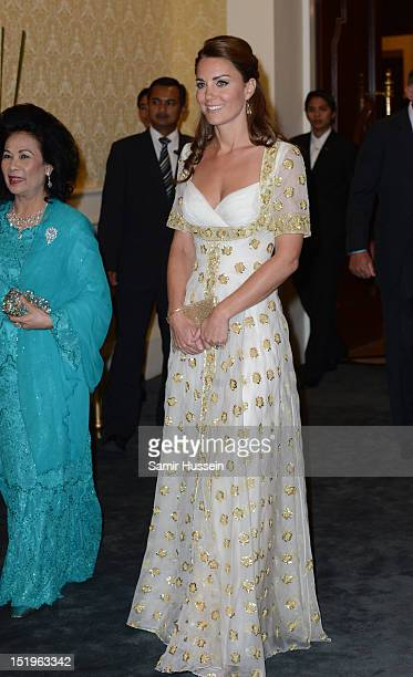 Catherine Duchess of Cambridge and Sultanah Tuanku Haminah binti Hamidun the Raja Permaisuri Agong of Malaysia attend an official dinner hosted by...