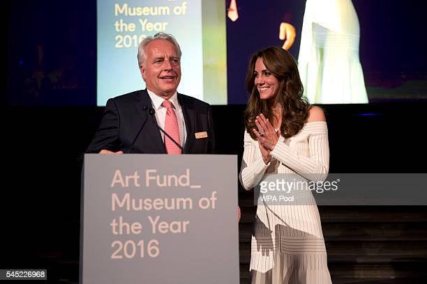 Catherine Duchess of Cambridge applauds Germany's Martin Roth the Director of the Victoria and Albert Museum as he speaks on stage in his capacity as...