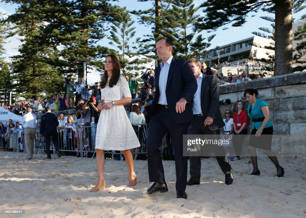 Catherine, Duchess of Cambridge arrives at a surf lifesaving demonstration with Australian Prime Minister <a gi-track='captionPersonalityLinkClicked' href=/galleries/search?phrase=Tony+Abbott&family=editorial&specificpeople=220956 ng-click='$event.stopPropagation()'>Tony Abbott</a> on Manly Beach on April 18, 2014 in Sydney, Australia. The Duke and Duchess of Cambridge are on a three-week tour of Australia and New Zealand, the first official trip overseas with their son, Prince George of Cambridge.