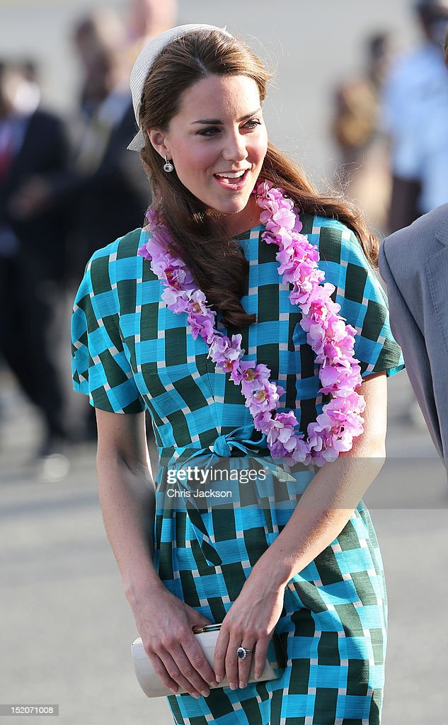 <a gi-track='captionPersonalityLinkClicked' href=/galleries/search?phrase=Catherine+-+Duchess+of+Cambridge&family=editorial&specificpeople=542588 ng-click='$event.stopPropagation()'>Catherine</a>, Duchess of Cambridge arrives at Honiara International Airport on day 6 of the royal couple's Diamond Jubilee tour of the Far East on September 16, 2012 in Honiara, Guadalcanal Island. Prince William, Duke of Cambridge and <a gi-track='captionPersonalityLinkClicked' href=/galleries/search?phrase=Catherine+-+Duchess+of+Cambridge&family=editorial&specificpeople=542588 ng-click='$event.stopPropagation()'>Catherine</a>, Duchess of Cambridge are on a Diamond Jubilee tour representing the Queen taking in Singapore, Malaysia, the Solomon Islands and Tuvalu.