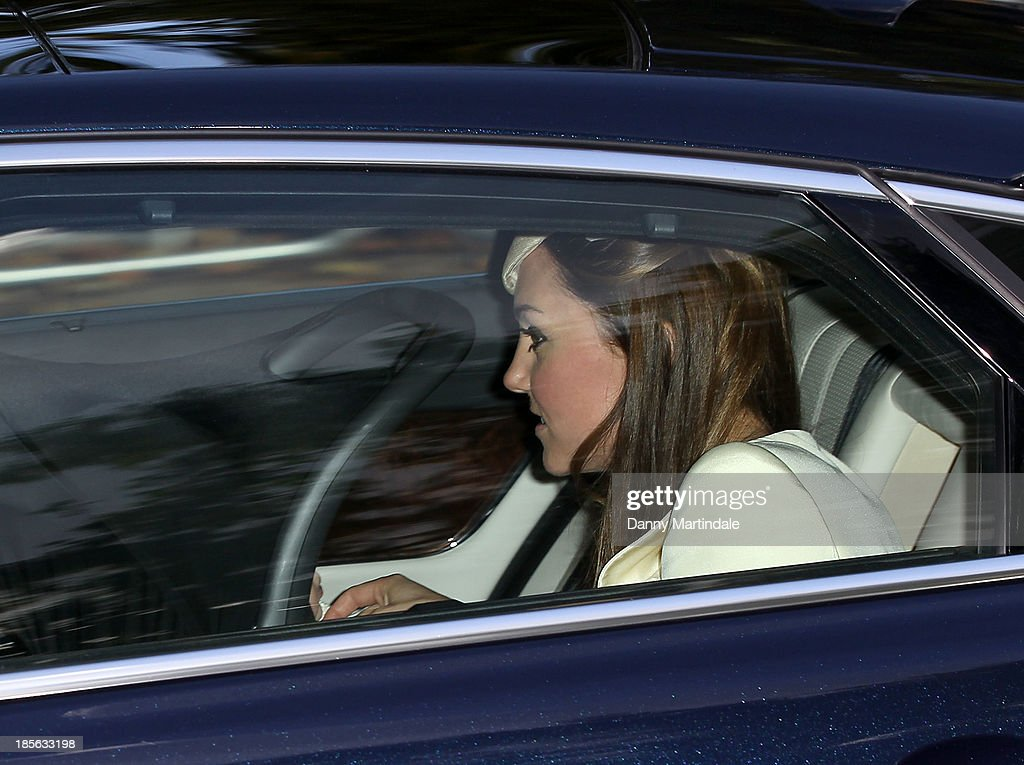 Catherine, Duchess of Cambridge arrives for Prince George's christening at St James' Palace on October 23, 2013 in London, England.