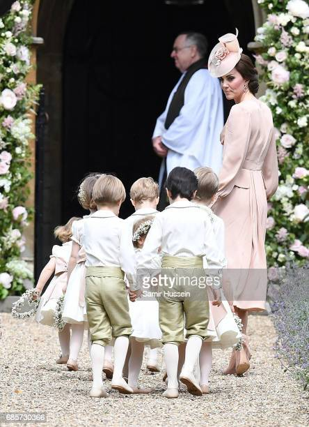 Catherine Duchess of Cambridge arrives with her children Prince George of Cambridge Pageboy and Princess Charlotte of Cambridge bridesmaid along with...