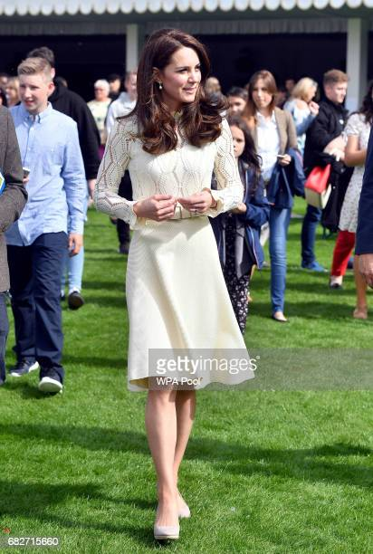 Catherine Duchess of Cambridge as they host a tea party in the grounds of Buckingham Palace to honour the children of those who have died serving in...