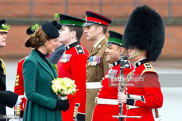 Catherine Duchess of Cambridge attends a St Patrick's Day parade by the 1st Battalion Irish Guards as she visits Aldershot Barracks on St Patrick's...