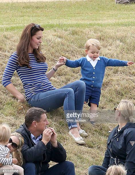 Catherine Duchess of Cambridge attends the Gigaset Charity Polo Match with Prince George of Cambridge at Beaufort Polo Club on June 14 2015 in...