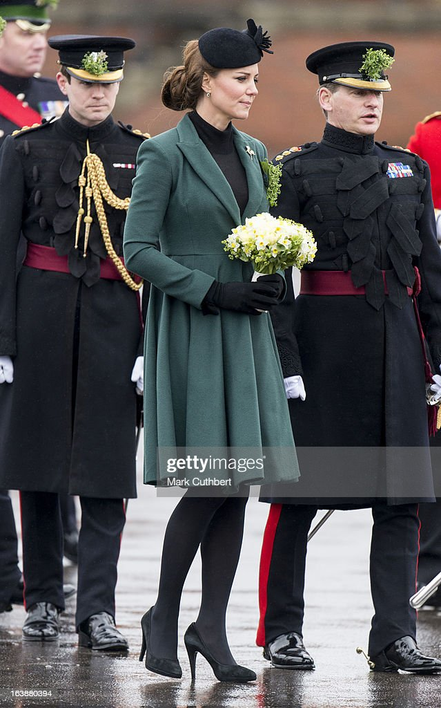 <a gi-track='captionPersonalityLinkClicked' href=/galleries/search?phrase=Catherine+-+Duchess+of+Cambridge&family=editorial&specificpeople=542588 ng-click='$event.stopPropagation()'>Catherine</a>, Duchess of Cambridge attends The Irish Guards St Patricks Day Parade, at Mons Barracks, where The Duchess presented the traditional sprigs of shamrock, on March 17, 2013 in Aldershot, England.