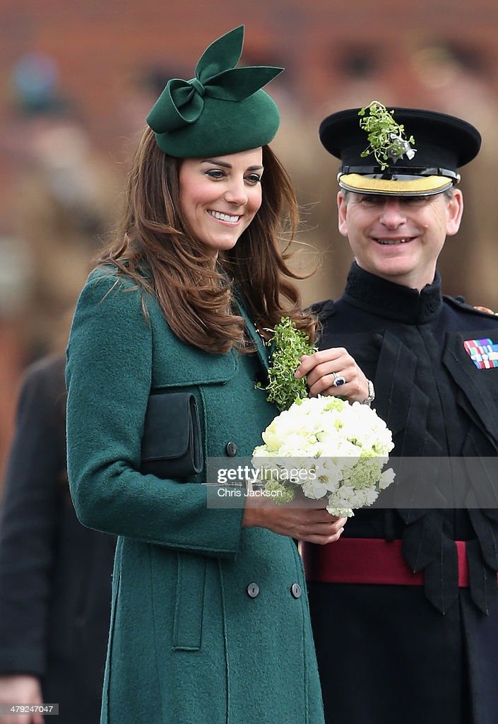 Catherine, Duchess of Cambridge attends the St Patrick's Day parade at Mons Barracks on March 17, 2014 in Aldershot, England. Catherine, Duchess of Cambridge and Prince William, Duke of Cambridge visited the 1st Battalion Irish Guards to present the traditional sprigs of Shamrocks to the Officers and Guardsmen of the Regiment.