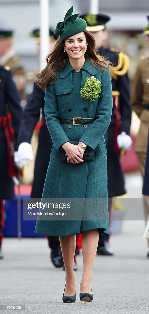 <a gi-track='captionPersonalityLinkClicked' href=/galleries/search?phrase=Catherine+-+Duchess+of+Cambridge&family=editorial&specificpeople=542588 ng-click='$event.stopPropagation()'>Catherine</a>, Duchess of Cambridge attends the St Patrick's Day Parade at Mons Barracks on March 17, 2014 in Aldershot, England. <a gi-track='captionPersonalityLinkClicked' href=/galleries/search?phrase=Catherine+-+Duchess+of+Cambridge&family=editorial&specificpeople=542588 ng-click='$event.stopPropagation()'>Catherine</a>, Duchess of Cambridge and Prince William, Duke of Cambridge visited the 1st Battalion Irish Guards to present the traditional sprigs of Shamrocks to the Officers and Guardsmen of the Regiment.
