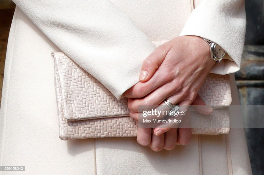 Catherine, Duchess of Cambridge (clutch detail) attends the traditional Easter Sunday church service at St George's Chapel, Windsor Castle on April 16, 2017 in Windsor, England.
