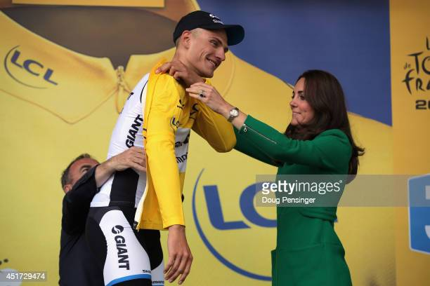 Catherine Duchess of Cambridge awards the overall race leader's yellow jersey to Marcel Kittel of Germany and Team GiantShimano after he won stage...